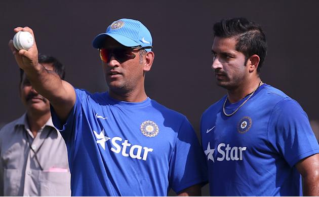 India's captain Dhoni talks to his team mate Sharma during a practice session ahead of their first one-day international cricket match against South Africa in Kanpur