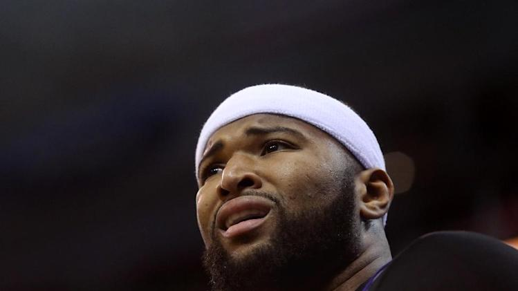 Sacramento Kings' center DeMarcus Cousins reacts from the bench as his team trails behind the Utah Jazz in the first half of an NBA basketball game on Saturday, Dec. 7, 2013, in Salt Lake City