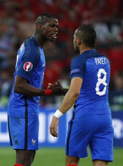 France's Dimitri Payet celebrates with Paul Pogba at the end of the match