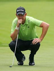 Greg Owen of England lines up his birdie putt on the ninth hole during the first round of the RBC Canadian Open at Hamilton Golf and Country Club, on July 26, in Ancaster, Ontario