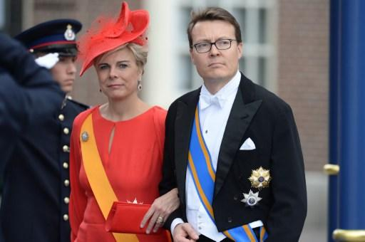 Prince Constantijn of the Netherlands and his wife Princess Laurentien arrive to attend on April 30, 2013 a reception held by King Willem-Alexander of the Netherlands at the Royal Palace in Amsterdam