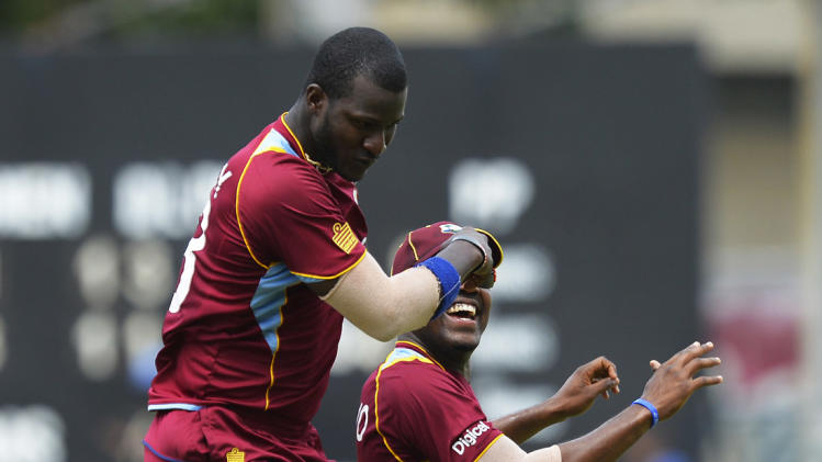 Darren Sammy celebrates the wicket of Virat Kohli during the India vs West Indies one-day international cricket match at Kingston, Jamaica, June 30, 2013.