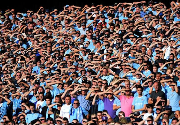 Manchester City supporters are seen during the English Premier League football match between Manchester City and Manchester United at the Etihad Stadium in Manchester, England, on September 22, 2013