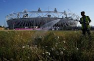 A gardener waters a patch of flowers near the Olympic stadium at the Olympic Park in London. London Mayor Boris Johnson insisted Sunday the city was ready to host the 2012 Olympics despite a national outbreak of pre-match nerves before the biggest show on Earth gets under way