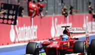 Ferrari's Spanish driver Fernando Alonso celebrates winning at the Valencia Street Circuit in Valencia during the European Formula One Grand Prix