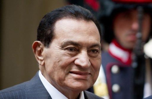 Ousted president Hosni Mubarak (pictured in 2010) has a build-up of fluid in his lungs and cracked ribs, Egypt's official news agency MENA reported after he was transferred from prison to military hospital for treatment.
