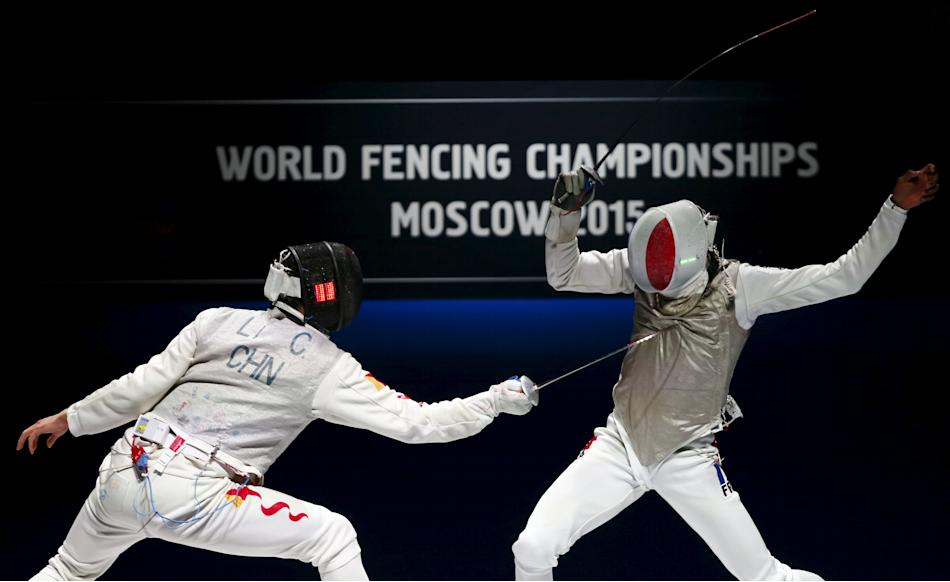 China's Li Chen competes against France's Lefort during their men's team foil third place match at World Fencing Championships in Moscow