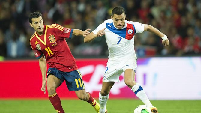 Spain's Pedro Rodriguez, left, fight for the ball with Chile's Alexis Sanchez, right, during a friendly soccer match between Spain and Chile at the Stade de Geneve stadium, in Geneva, Switzerland, Tuesday, Sept. 10, 2013