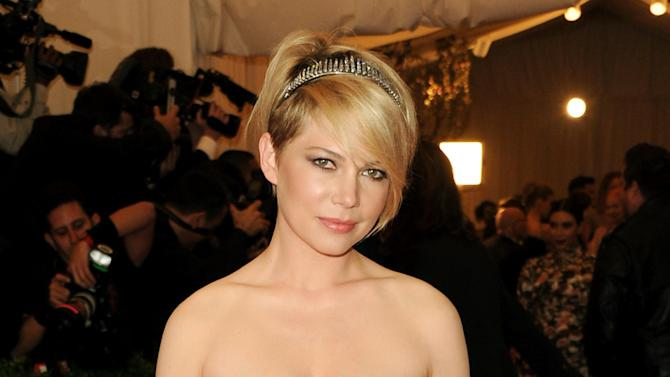 """FILE - This May 6, 2013 file photo shows actress Michelle Williams at The Metropolitan Museum of Art Costume Institute gala benefit, """"Punk: Chaos to Couture"""" in New York. Williams will make her Broadway debut in a role best known by Liza Minnelli _ party girl Sally Bowles in """"Cabaret."""" The Roundabout Theatre Company confirmed Wednesday, Sept 4, that the former """"Dawson's Creek"""" and """"Brokeback Mountain"""" star will join Alan Cumming in the revival. Previews will begin March 21 with an opening set for April 24 at the Studio theater 54 on Broadway. (Photo by Evan Agostini/Invision/AP, File)"""