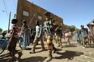 French troops patrol in the streets of Gao on February 3, 2013. France said it carried out major air strikes Sunday near Kidal, the last bastion of armed extremists chased from Mali's desert north in a lightning French-led offensive, after a whirlwind visit by President Francois Hollande