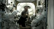 NASA astronauts Chris Cassidy and Tom Marshburn don their NASA-issue Extravehicular Mobility Units for an emergency spacewalk to find an ammonia link outside the International Space Station. Canadian astronaut Chris Hadfield (center) and Russia