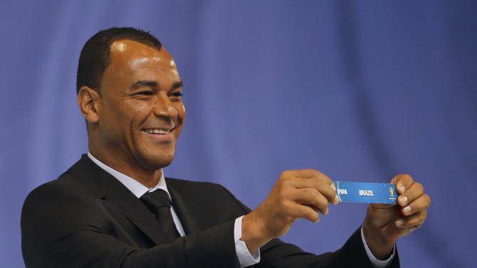 "Cafu holds the slip showing ""Brazil' during the draw for the 2014 World Cup in Sao Joao da Mata"