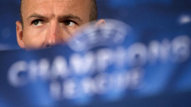 Bayern Munich's Arjen Robben speaking during a press conference in London, Tuesday, Feb. 18, 2014, ahead of their last-16 Champions League soccer match against Arsenal on Wednesday