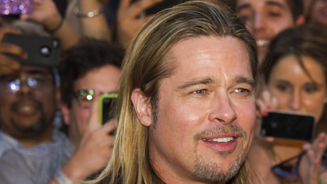 """Brad Pitt attends the """"World War Z"""" premiere on Monday, June 17, 2013, in New York. (Photo by Charles Sykes/Invision/AP)"""