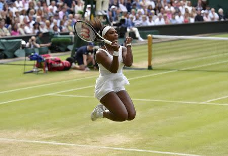 Serena Williams of the U.S.A. celebrates after winning her match against Victoria Azarenka of Belarus at the Wimbledon Tennis Championships in London