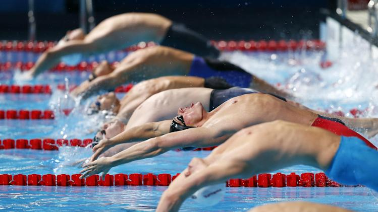 United States's Ryan Lochte, centre, starts on his way to winning the gold medal in the Men's 200m backstroke final at the FINA Swimming World Championships in Barcelona, Spain, Friday, Aug. 2, 2013. (AP Photo/Daniel Ochoa de Olza)