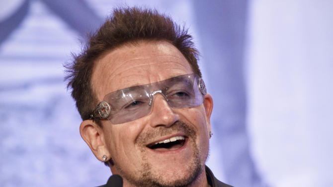 "FILE - In this Friday, May 18, 2012 file photo, Bono, the Irish rock star and activist, speaks at the Symposium on Global Agriculture and Food Security following an appearance by President Barack Obama at the Ronald Reagan Building in Washington. It appeared Bono and arachnids didn't mix when his ""Spider-Man"" musical had a rough Broadway run, but that didn't keep a biologist from naming an actual spider species after the U2 singer. Jason Bond of Auburn University has identified 33 new species of trapdoor spider, including three of them in the California desert at Joshua Tree National Park. The park's namesake is featured in the title and cover of U2's 1987 album, ""The Joshua Tree."" (AP Photo/J. Scott Applewhite, File)"