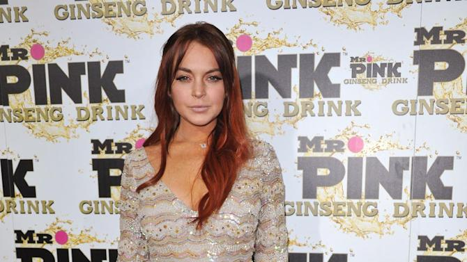 FILE - In this Oct. 11, 2012 file photo, Lindsay Lohan attends the Mr. Pink Ginseng launch party at the Beverly Wilshire hotel in Beverly Hills, Calif. A scheduling hearing for a case alleging Lohan lied to police, drove recklessly and obstructed officers from performing their duties is scheduled for Wednesday, Jan. 30, 2013 before a judge who has previously sentenced the actress to house arrest and jail time. (Photo by Richard Shotwell/Invision/AP, File)