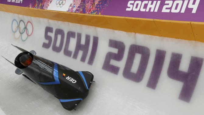 Germany's two-men bobsleigh pilot Arndt speeds down the track during an unofficial men bobsleigh progressive training at the Sanki sliding center in Rosa Khutor, a venue for the Sochi 2014 Winter Olympics near Sochi