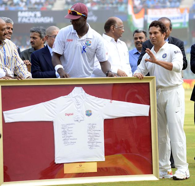 West Indian Captain Darren Sammy presents a memorabilia - a T-Shirt signed by all the West Indian players during his 200th and the last Test Match at Wankhede stadium in Mumbai on Nov.14, 2013. (Photo