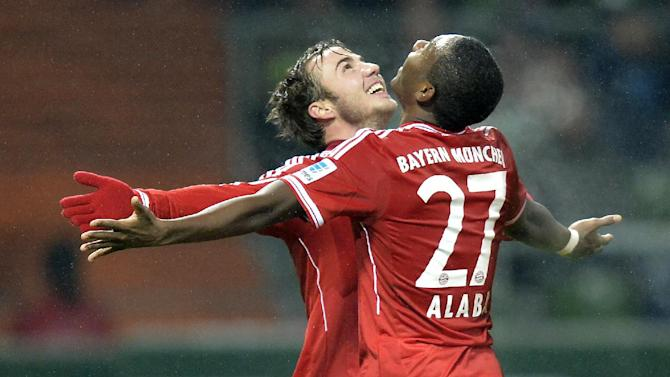 Bayern's scorer Mario Goetze, left, celebrates his goal with Bayern's David Alaba of Austria during the German Bundesliga soccer match between Werder Bremen and Bayern Munich in Bremen, Germany, Saturday, Dec. 7, 2013. Bayern defeated Bremen with 7-0