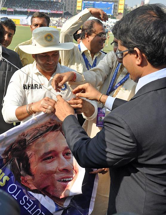 Former Indian cricketer Sourav Ganguly and master blaster Sachin Tendulkar with laters poster during the 3rd day of the 1st test match between India and West Indies at Eden Gardens, Kolkata on Nov. 8,