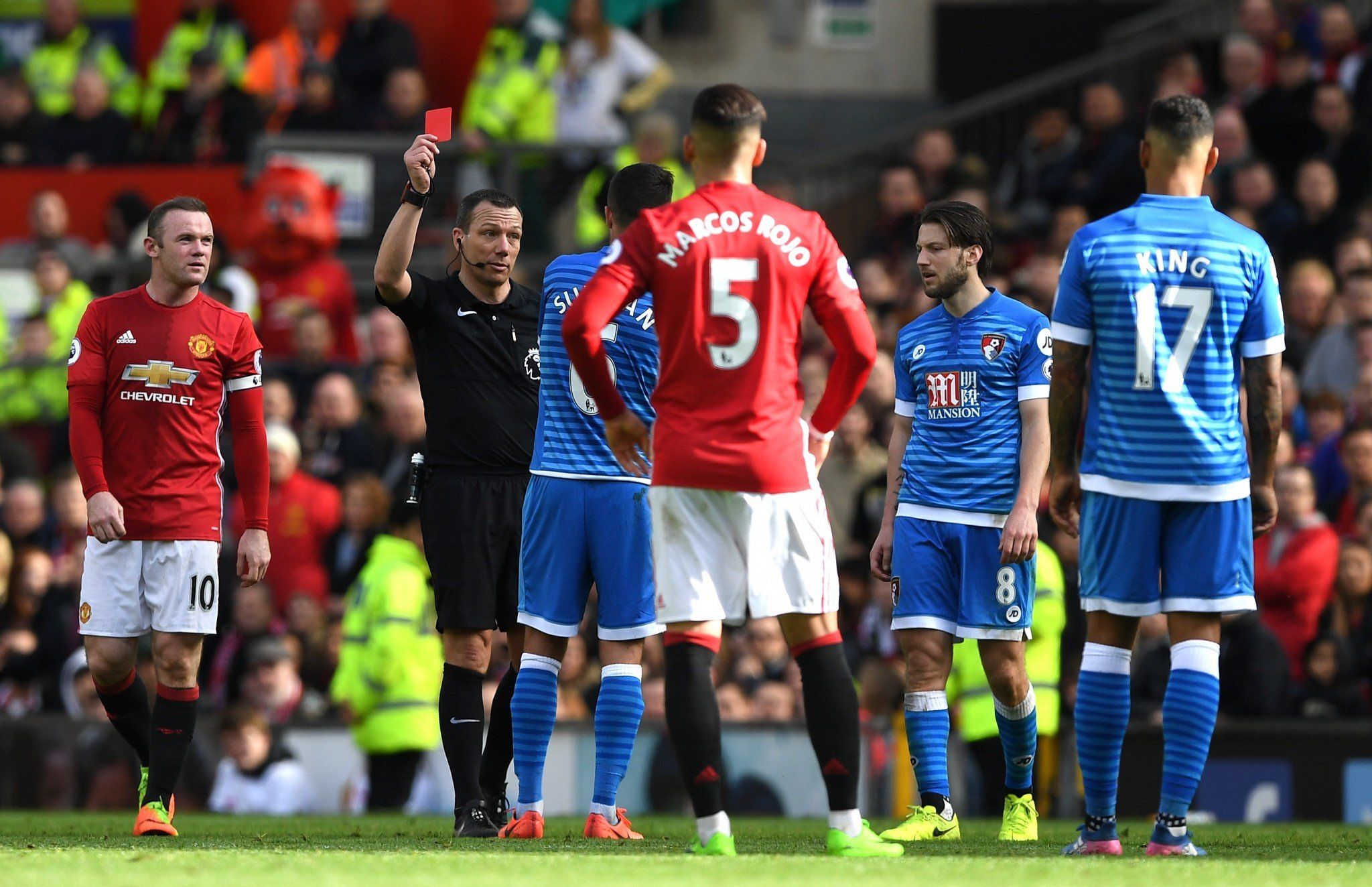 Kevin Friend remembers he has already booked Andrew Surman so shows him a red card
