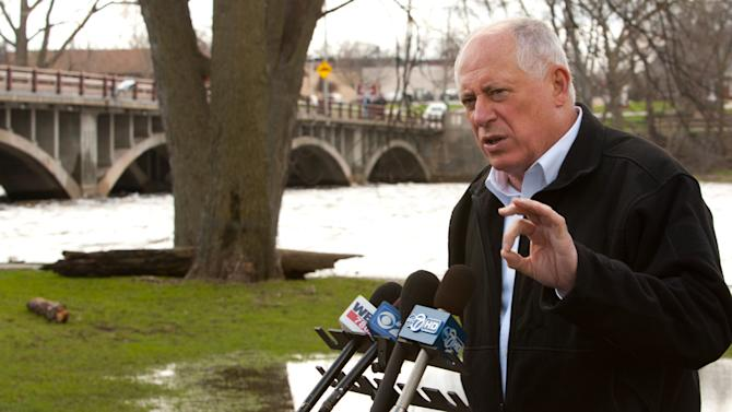 Gov. Pat Quinn addresses flooding concerns throughout the state, during a press conference along the Fox River, Saturday, April 20, 2013 in North Aurora, Ill. (AP Photo/Daily Herald, Daniel White) MANDATORY CREDIT; MAGS OUT; TV OUT