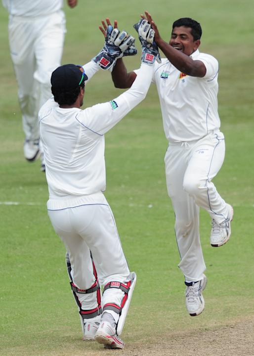 Sri Lanka's Dinesh Chandimal, left, celebrates with fellow team member Rangana Herath after taking the wicket of South Africa's Jacques Kallis for a second duck during their second five-day cricket te