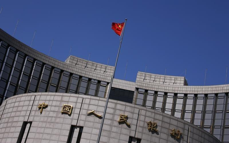 China makes big cut in bank reserve requirement to fight slowdown