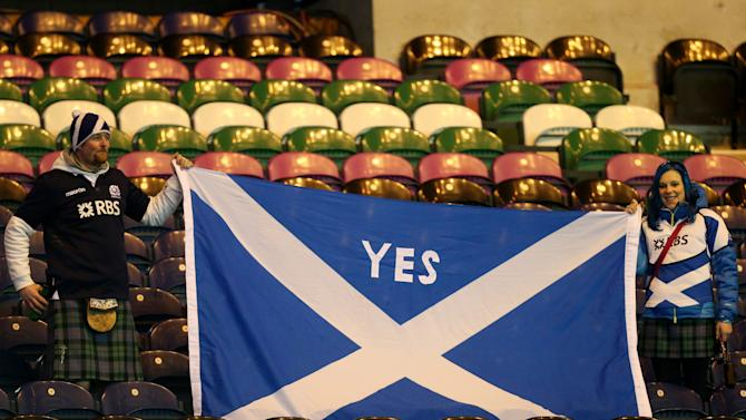 Scottish rugby fans are seen holding a Saltire flag at the end of the Six Nations rugby union international match between Scotland and France at Murrayfield in Edinburgh, Scotland, Saturday March 8, 2014. (AP Photo/Scott Heppell)