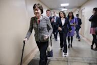Sen. Susan Collins, R-Maine, followed by Sen. Kamala Harris, D-Calif., walk to the Senate chamber on Capitol Hill in Washington, Friday, Feb. 17, 2017, for the final vote to confirm Scott Pruitt to lead the Environmental Protection Agency. (AP Photo/J. Scott Applewhite)