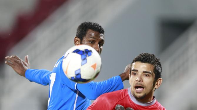 Martin of Qatar's Lekhwiya fights for the ball with Bureshaid of Bahrain's Al-Hidd during their AFC Champions League match in Doha