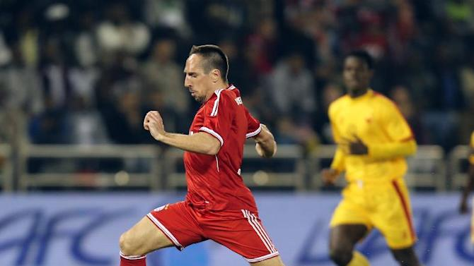 Bayern Munich's player Franck Ribery, left, challenges Sudan's Ramadan Alagab of Al-Merreikh, during their friendly soccer match, at Al-Saad stadium in Doha Thursday, Jan. 9, 2014