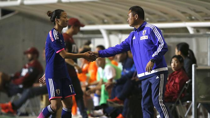 Japan's women's national soccer team head coach Sasaki congulatulates Ogimi as she is substituted during their women's international friendly soccer match against Italy in Nagano, central Japan