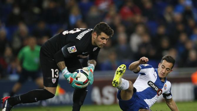 Athletic Bilbao's goalkeeper Herrerin blocks the ball against Espanyol's Vazquez during their semifinal second leg Spanish King's Cup trophy match, near Barcelona