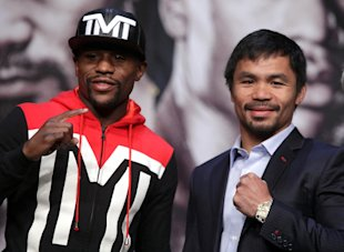 Floyd Mayweather Jr. (L) and Manny Pacquiao pose during a news conference on Wednesday. (AFP)