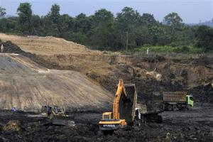 File photo of trucks and machinery being pictured at a PT Exploitasi Energi Indonesia Tbk coal mine in Samarinda