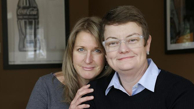 This photo taken Feb. 8, 2013, shows Sandy Stier, left, and Kris Perry, the couple at the center of the Supreme Court's consideration of gay marriage, at their home in Berkeley, Calif.  Whatever the outcome of their momentous case, Perry and Stier, who have been together 13 years, will be empty-nesters as the last of their children will heads off to college. (AP Photo/Jeff Chiu)