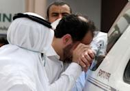 A father of one of the victims cries for the loss of his son outside Doha's Villaggio Mall after a fire broke out inside the Gulf emirate's upscale shopping centre, killing at least 19 people, including 13 children