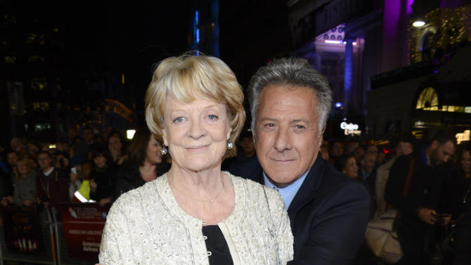 "FILE - In this Oct. 15, 2012 file photo, Dame Maggie Smith and Dustin Hoffman pose at London Film Festival American Airlines Gala - Quartet at Odeon West End in London. The 75-year-old Hoffman went behind the camera for ""Quartet,"" starring Maggie Smith, Tom Courtenay, Billy Connolly and Pauline Collins as aging British opera divas at a retirement home for musicians who put aside past differences for a reunion concert. (Photo by Jon Furniss/Invision/AP, File)"
