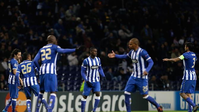 Porto players celebrate after Jackson Martinez, centre, scored their side's goal during the Champions League group G soccer match between FC Porto and Austria Vienna Tuesday, Nov. 26, 2013, at the Dragao stadium in Porto, northern Portugal