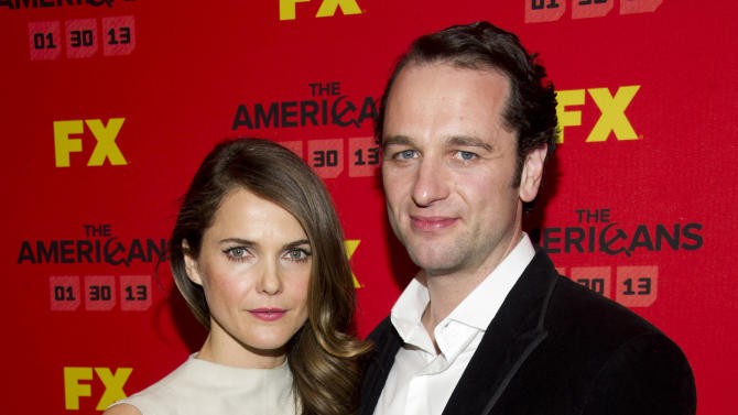 """FILE - This Jan. 26, 2013 photo shows Keri Russell left, and Matthew Rhys at the premiere of the FX television series """"The Americans"""" in New York.  The new FX drama, airing Wednesday at 10 p.m. EST on FX, focuses on two KGB spies posing as an ordinary American couple shortly after Ronald Reagan was elected president. (Photo by Charles Sykes/Invision/AP, file)"""