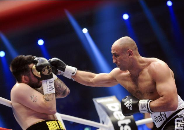 German WBO super-middleweight boxer Arthur Abraham exchange punches with his challenger Britain's Paul Smith during their title fight in Berlin