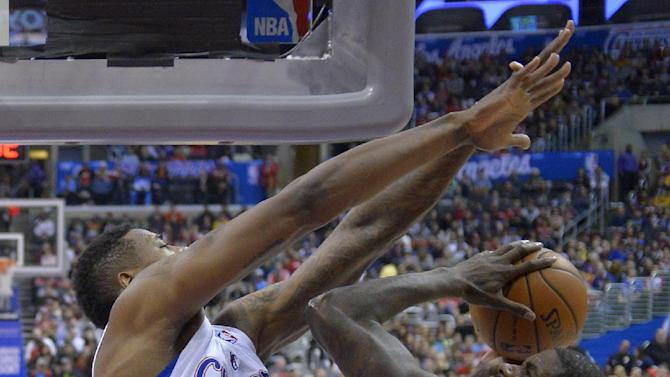 Utah Jazz forward Marvin Williams, right, puts up a shot as Los Angeles Clippers center DeAndre Jordan defends during the second half of an NBA basketball game, Saturday, Feb. 1, 2014, in Los Angeles