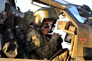 Britain's Prince Harry does a systems check in the cockpit of his Apache helicopter, November 2, 2012, at Camp Bastion in Afghanistan's Helmand Province. Harry said he killed Taliban fighters during his stint as a helicopter gunner in Afghanistan, in comments that can be reported after he completed his tour of duty Monday.