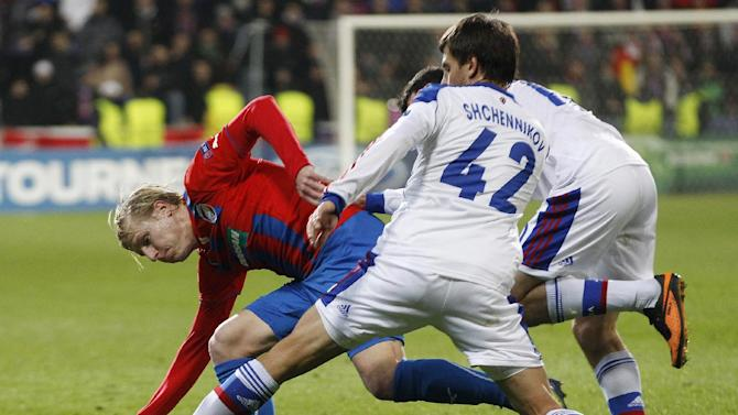 Moscow's Georgi Schennikov, right, challenges Viktoria Pilsen's Frantisek Rajtoral, left, during the Champions League Group D soccer match between Viktoria Pilsen and CSKA Moscow in Pilsen, Czech Republic, Tuesday, Dec. 10, 2013. Pilsen won the match 2-1