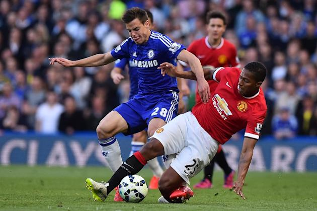 Manchester United's Antonio Valencia (R) challenges Chelsea's Cesar Azpilicueta during their English Premier League match, at Stamford Bridge in London, on April 18, 2015