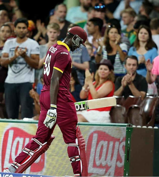 West Indies batsman Jason Holder leaves the field after he was dismissed for 56 runs during their Cricket World Cup Pool B match against South Africa in Sydney, Australia, Friday, Feb. 27, 2015. (AP P