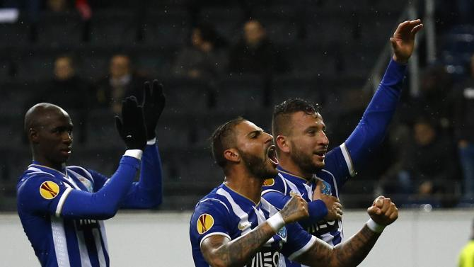 Porto's players react after their Europa League soccer match against Eintracht Frankfurt in Frankfurt